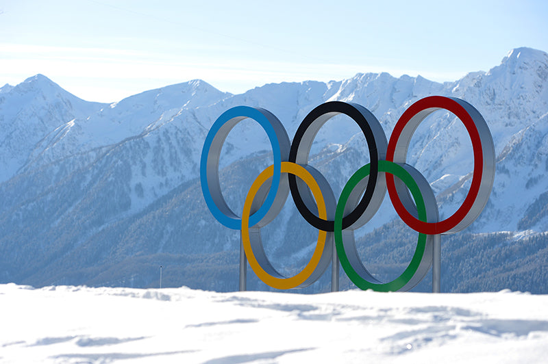 The Olympic Rings standing up on a snow-covered mountain