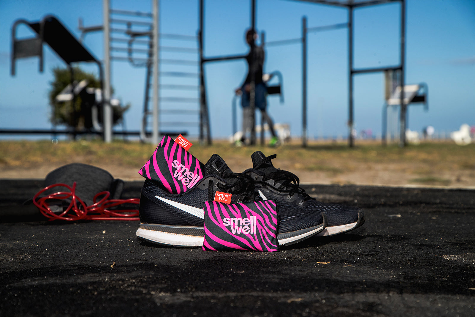 A Pair of SmellWell Active - Pink Zebra in a pair of black runningshoes