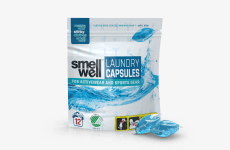 A package of SmellWell Laundry Capsules and 2 laundry capsules