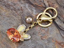 Load image into Gallery viewer, Swarovski Crystal Topaz Bunny Rabbit Bowtie Pearl Bead Keychain