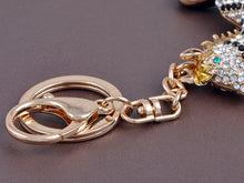 Load image into Gallery viewer, Galloping Striped Blonde Horse With Bright Blue Zircon Eye Keychain