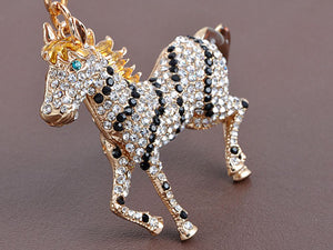 Galloping Striped Blonde Horse With Bright Blue Zircon Eye Keychain
