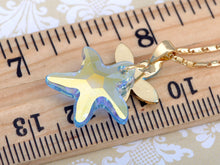 Load image into Gallery viewer, Swarovski Crystal Aquamarine Light Sapphire Shedding Starfish Element Necklace