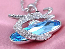 Load image into Gallery viewer, Swarovski Crystal Encrusted Dragon Clutches Oval Aquamarine Blue Pendant