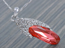 Load image into Gallery viewer, Swarovski Crystal Border With Oval Red Gems Pendant