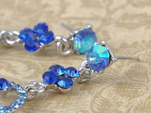 Silver Sapphire Blue Colored Sea Swirl Waves Dangle Earrings
