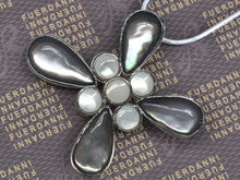 Load image into Gallery viewer, Cat Eye Flower Cut Out Petals Milky Center Cross Pendant Necklace
