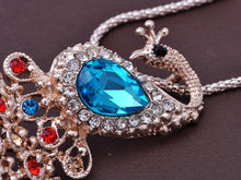 Load image into Gallery viewer, Swarovski Crystal Faux Pearl Light Blue Feather Peacock Pendant Necklace
