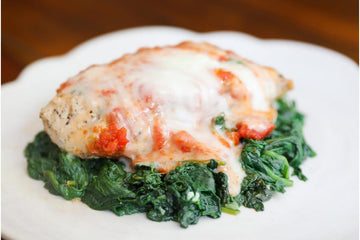 Lucy's Chicken Parmesan over Baby Spinach