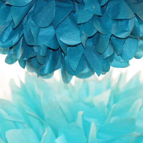 PomAdore's aquamarine and turquoise paper poms bring the beach to birthday parties, showers and weddings.
