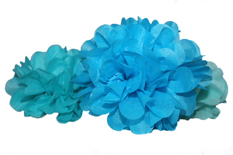 PomAdore's mini tissue paper poms add a splash of color to beach theme weddings and bridal showers.