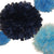 PomAdore's Blue Moon tissue paper pom set surrounds a XL navy pom in a sea of lighter blues.
