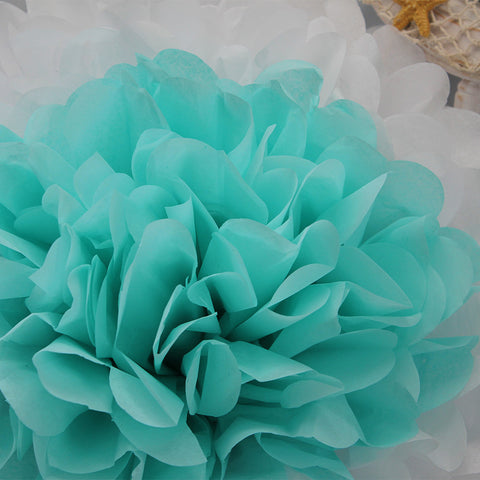 PomAdore's original tissue paper pom flower in aquamarine and white.
