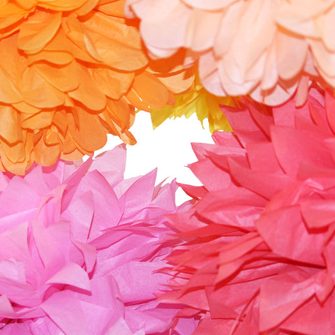 Sorbet shades make PomAdore's tissue paper poms a terrific spring or summer time party decoration.