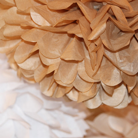 A naturally neutral collection of sand colored tissue paper poms in PomAdore's beach themed set Walk on the Beach.