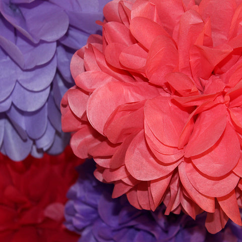 PomAdore's Red Hat party poms features a colorful party mix of red, purple and pink.