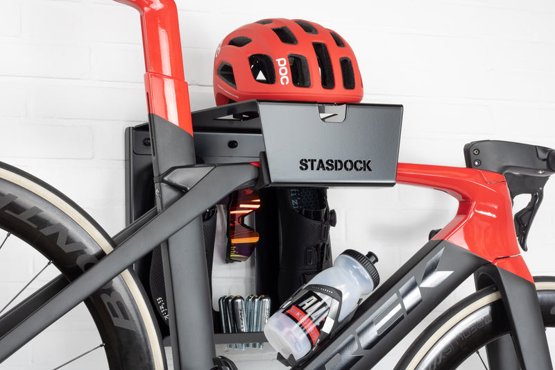 black stasdock bike wall mount attached to racing bike with bicycle accessories