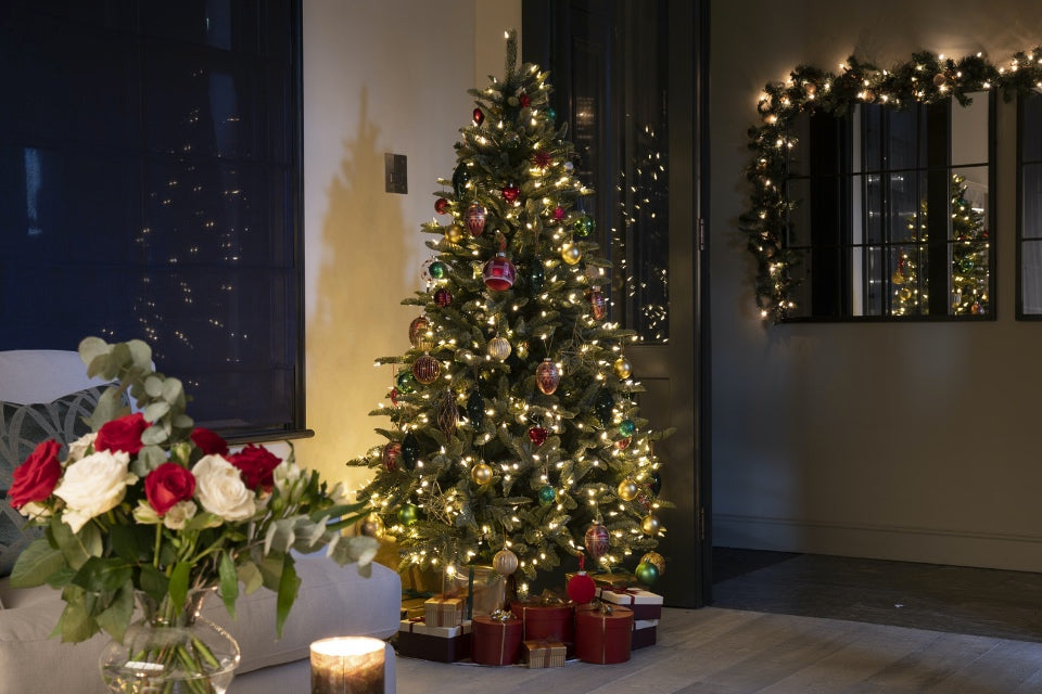 Christmas Tree in london townhouse reception room at night