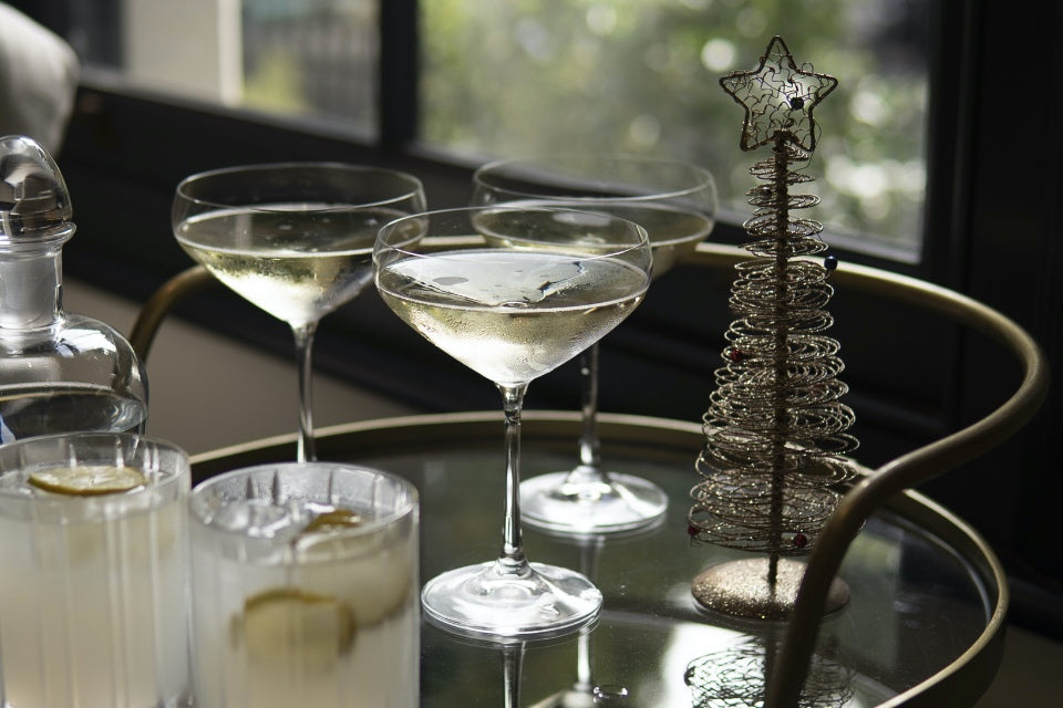 Drinks caddy with cocktails and a bronze display Christmas tree decoration