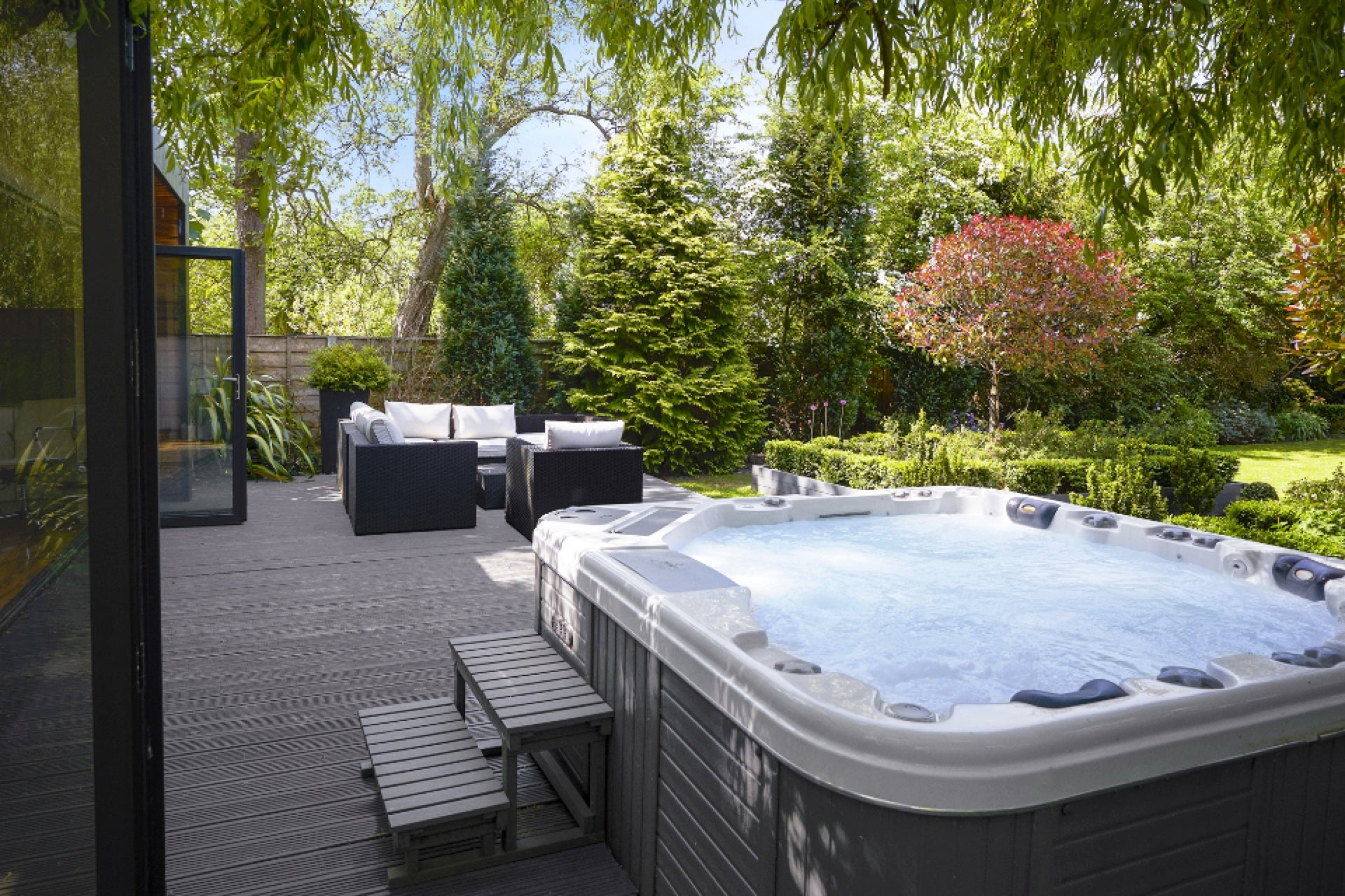 Hot tub and terrace in garden