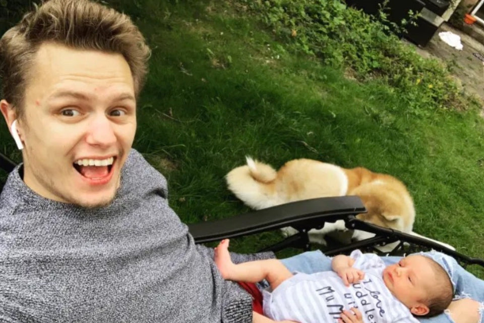 Man with baby and dog