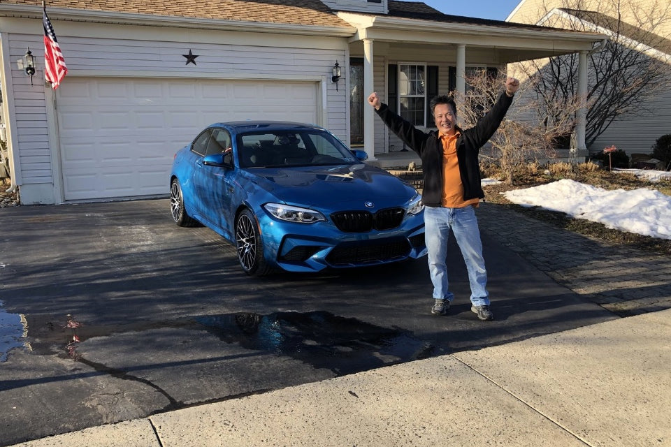 Man winning a BMW