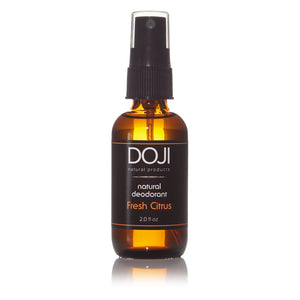 Doji natural deodorant, bottle product shot, fresh citrus scent, amber glass spray bottle, on white background with reflection.