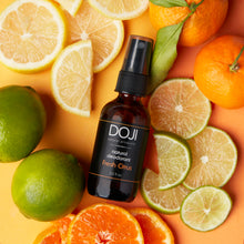 Load image into Gallery viewer, Doji natural deodorant, fresh citrus scent, overhead shot with cut limes, lemons, oranges, tangerines, mandarins.