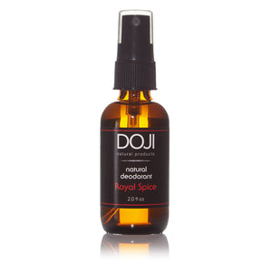 Doji natural deodorant, bottle product shot, royal spice scent, amber glass spray bottle, on white background with reflection.