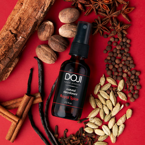 Doji natural deodorant, royal spice scent, overhead shot with spices, cardamom, vanilla bean, cloves, allspice, nutmeg, sandalwood, and star anise.