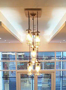 Chandelier designed with reclaimed Barbicide jars by Stephanie Reppas - barber style decor salon hair beard
