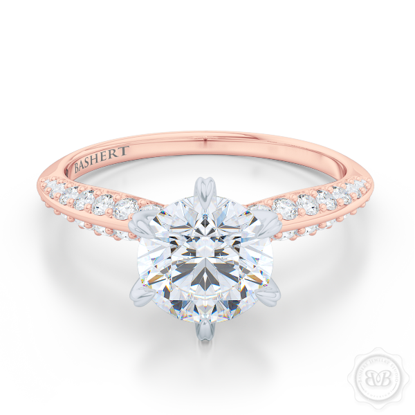 Classic Six-Prong Round Solitaire Engagement Ring. Elegantly beveled knife-edge Diamond shoulders. Handcrafted in two-tone Rose Gold and Platinum. Charles & Colvard Round Brilliant Moissanite. Free Shipping USA.  30Day Returns | BASHERT JEWELRY | Boca Raton Florida