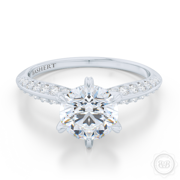 Classic Six-Prong Round Solitaire Engagement Ring. Elegantly beveled knife-edge Diamond shoulders. Handcrafted in White Gold or Platinum. Charles & Colvard Round Brilliant Moissanite. Free Shipping USA.  30Day Returns | BASHERT JEWELRY | Boca Raton Florida