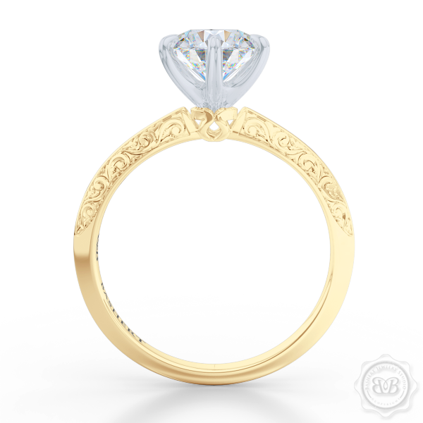 Classic knife-edge, Six-Prong Round Solitaire Engagement Ring. Crafted in Classic Yellow Gold. Elegantly hand-engraved shoulders. FOREVER ONE Round Brilliant Moissanite. Free Shipping USA. 30-Day Returns | BASHERT JEWELRY | Boca Raton, Florida