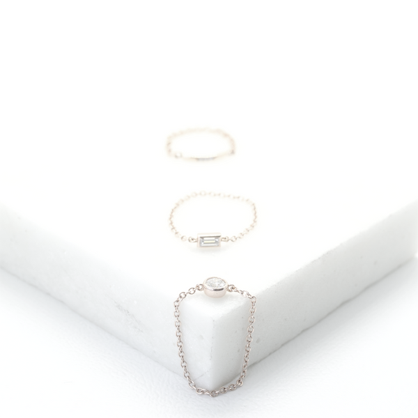 Fashion, stackable ring, featuring bezel set round diamond, suspended on a filigree chain. Hand-fabricated in ethically sourced, solid White Gold. | Free Shipping on all orders in The USA. |  Bashert Jewelry.  Boca Raton Florida.