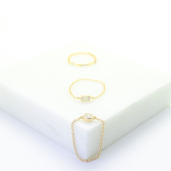 Fashion, stackable ring, featuring bezel set round diamond, suspended on a filigree chain. Hand-fabricated in ethically sourced, solid Yellow Gold. | Free Shipping on all orders in The USA. |  Bashert Jewelry.  Boca Raton Florida.