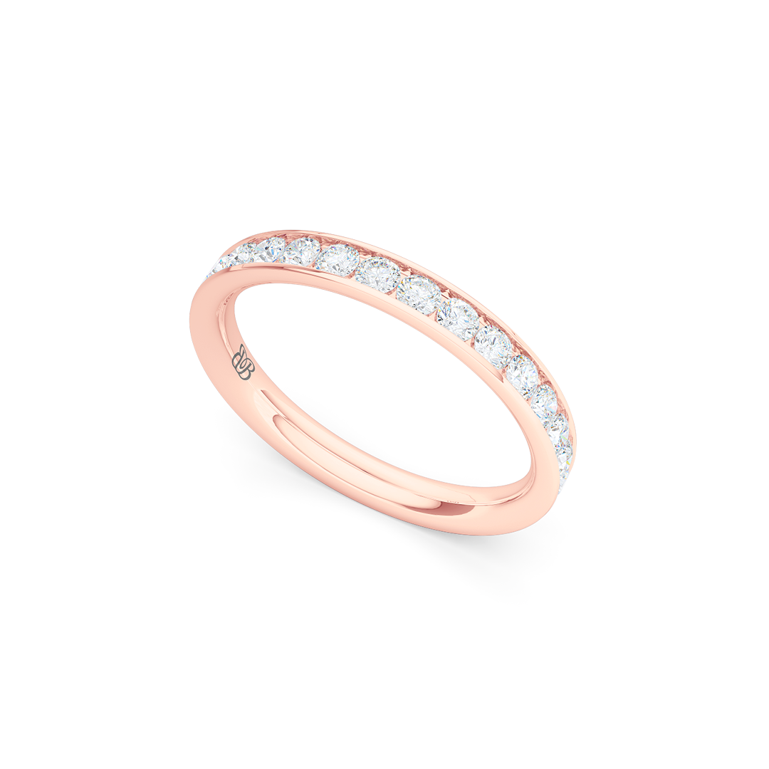 Classic, channel-set Diamond Eternity Wedding Ring. Elegant lines, handcrafted in Romantic Rose Gold and Round Brilliant Diamonds. Free Shipping for All USA Orders. 15 Day Returns | BASHERT JEWELRY | Boca Raton, Florida