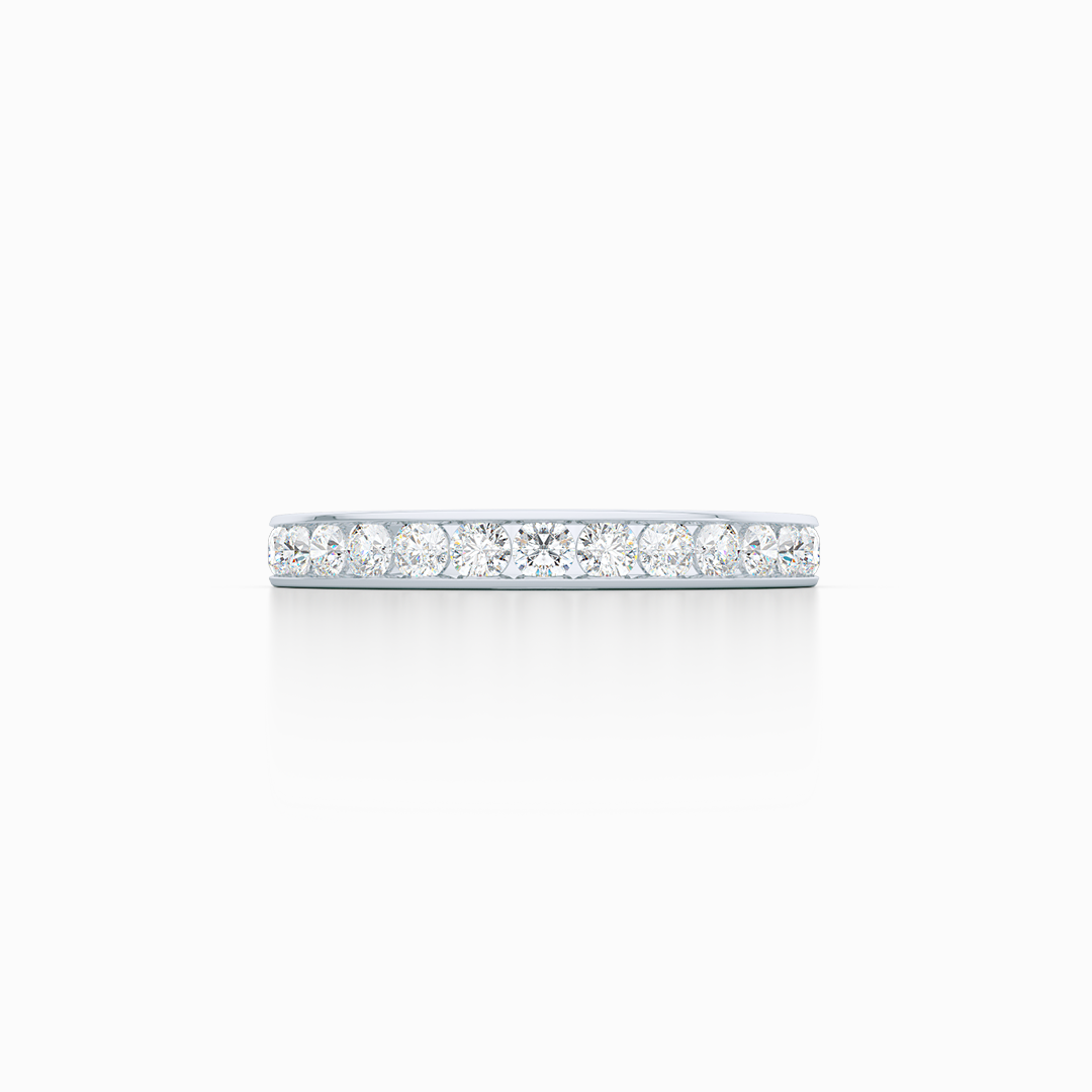 Classic, channel-set Diamond Eternity Wedding Ring. Elegant lines, handcrafted in White Gold or Platinum, and Round Brilliant Diamonds. Free Shipping for All USA Orders. 15 Day Returns | BASHERT JEWELRY | Boca Raton, Florida