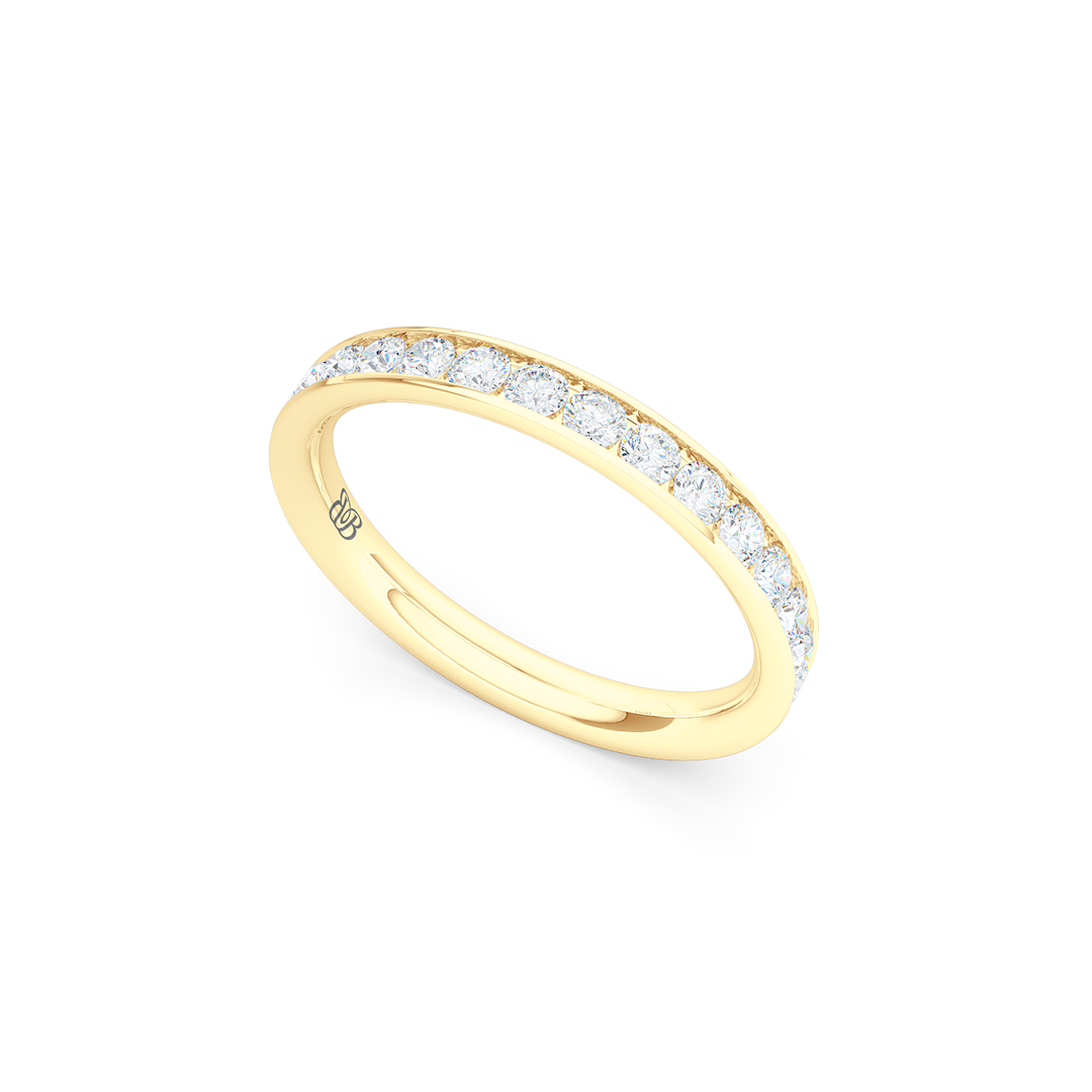 Classic, channel-set Diamond Eternity Wedding Ring. Elegant lines, handcrafted in Classic Yellow Gold and Round Brilliant Diamonds. Free Shipping for All USA Orders. 15 Day Returns | BASHERT JEWELRY | Boca Raton, Florida