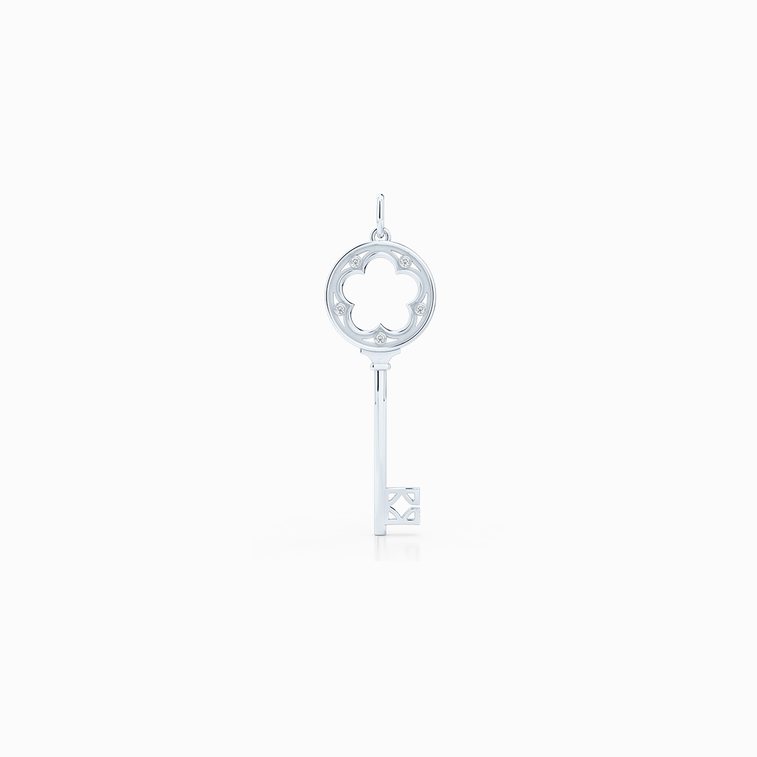 A classic Clover Key Pendant with an elegant appeal. Hand-fabricated in sustainable, solid White Gold. Adorned with 0.05ct Round Brilliant Diamond Set in Soft Bezel Pots. Free Shipping for All USA Orders. 15 Day Returns | BASHERT JEWELRY | Boca Raton, Florida