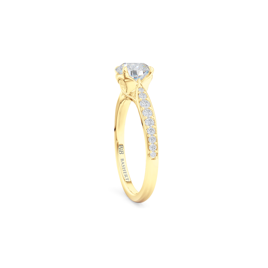 Award-Winning, Round Solitaire Engagement Ring. Hand-fabricated in solid, sustainable Yellow Gold. Signature Heart Crown showcasing a Charles & Colvard, Forever One Round Brilliant Moissanite. Diamond Shoulders. Free Shipping USA. 15 Day Returns | BASHERT JEWELRY | Boca Raton, Florida