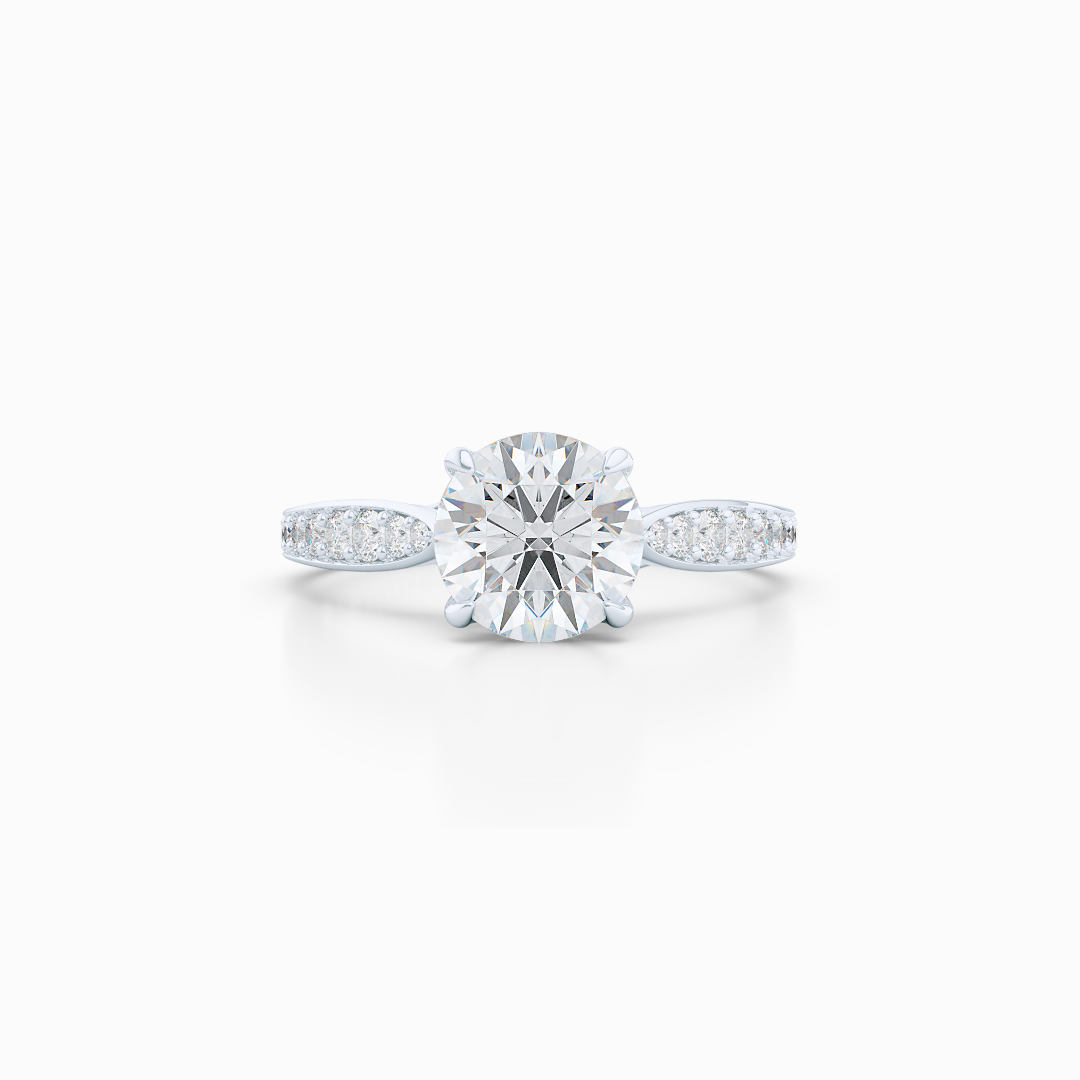 Award-Winning, Round Solitaire Engagement Ring. Hand-fabricated in solid, sustainable White Gold. Signature Heart Crown showcasing a Charles & Colvard, Forever One Round Brilliant Moissanite. Diamond Shoulders. Free Shipping USA. 15 Day Returns | BASHERT JEWELRY | Boca Raton, Florida