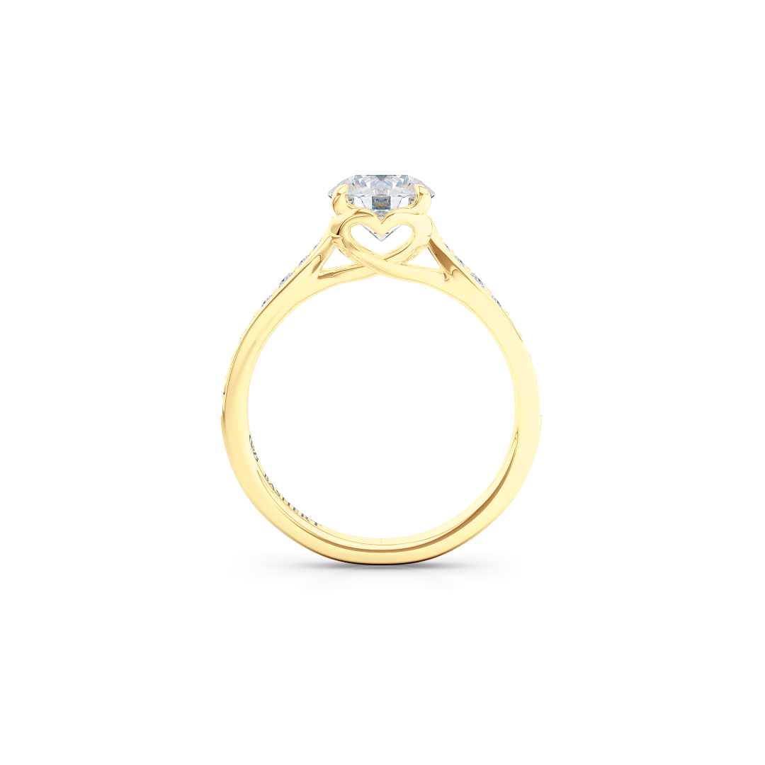 Award-Winning Round Solitaire Engagement Ring. Hand-fabricated in solid, sustainable Yellow Gold. Signature Heart Crown showcasing a handpicked, GIA certified Round Brilliant Diamond. Diamond Shoulders. Free Shipping USA. 15 Day Returns | BASHERT JEWELRY | Boca Raton, Florida