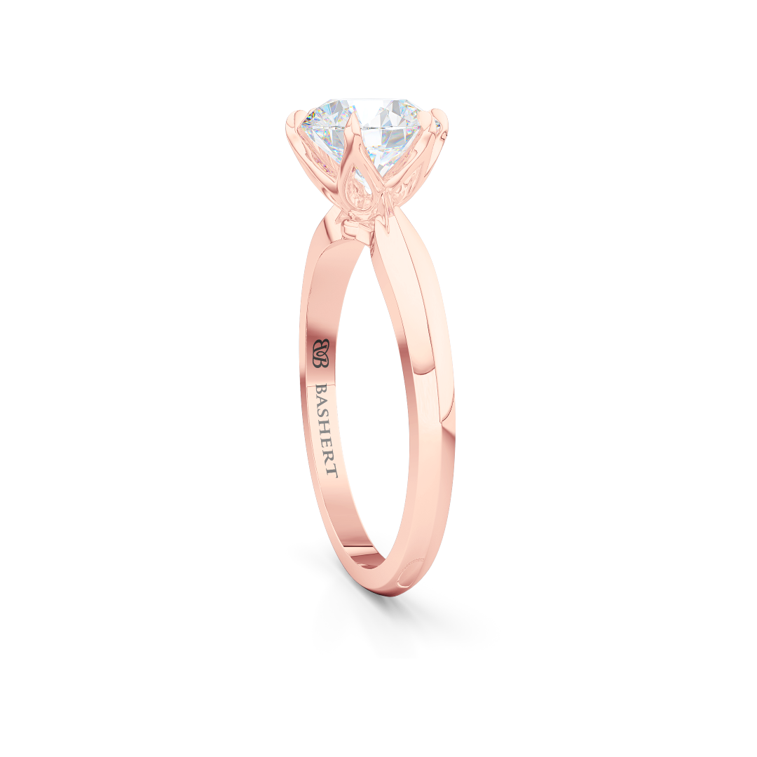 Elegant six-prong Solitaire Engagement Ring. Hand-fabricated in sustainable, solid Romantic Rose Gold and Charles & Colvard Forever One, Round Brilliant Moissanite.  Free Shipping for All USA Orders. 15-Day Returns | BASHERT JEWELRY | Boca Raton, Florida