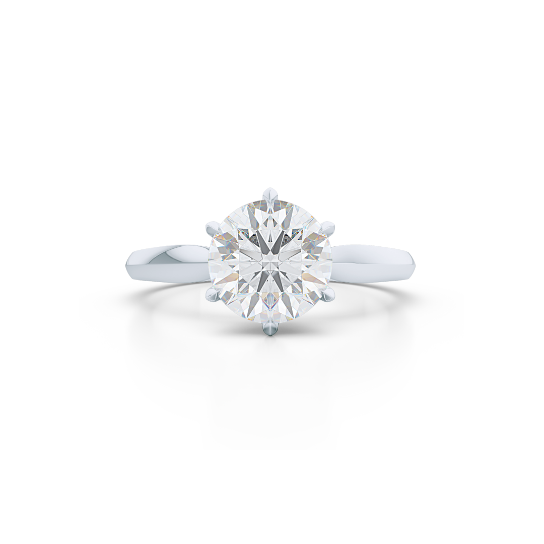 Elegant six-prong Solitaire Engagement Ring. Hand fabricated in solid, sustainable White Gold, or Platinum 950, and handpicked Charles & Colvard Forever One, Round Brilliant Moissanite.  Free Shipping for All USA Orders. 15-Day Returns | BASHERT JEWELRY | Boca Raton, Florida