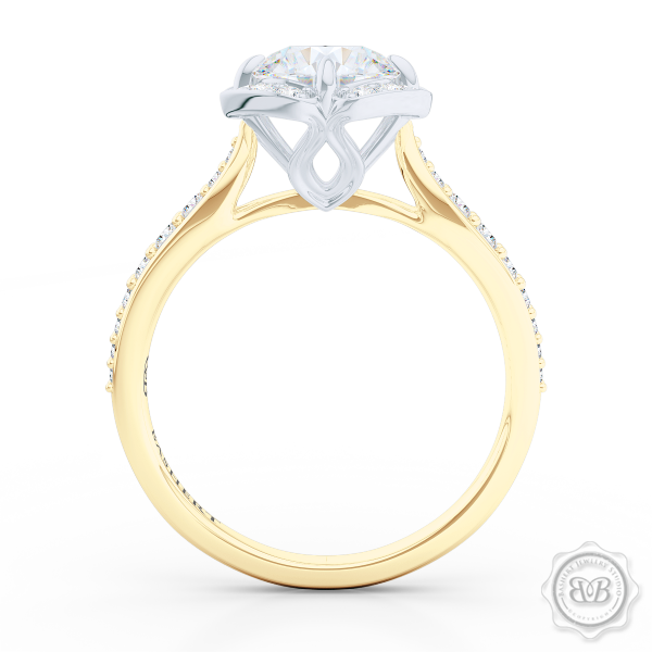 Exquisite round East-West Halo engagement ring. Crafted in Classic Yellow Gold and Platinum. Charles & Colvard Round Brilliant Forever One Moissanite.  Elegant bead-set Diamond encrusted shoulders. Free Shipping USA. 30-Day Returns | BASHERT JEWELRY | Boca Raton, Florida.