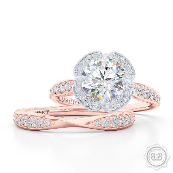 Exquisite round East-West Halo engagement ring. Crafted in Romantic Rose Gold and Platinum. Charles & Colvard Round Brilliant Forever One Moissanite.  Elegant bead-set Diamond encrusted shoulders. Free Shipping USA. 30-Day Returns | BASHERT JEWELRY | Boca Raton, Florida.