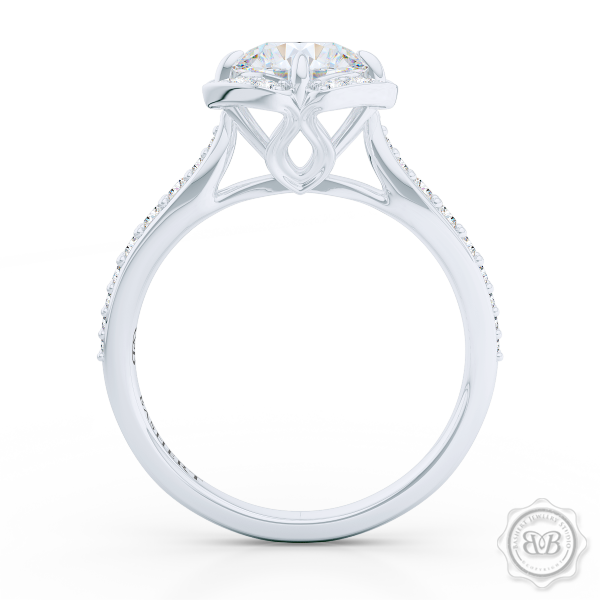 Exquisite round East-West Halo engagement ring. Crafted in White Gold and Platinum. Charles & Colvard Round Brilliant Forever One Moissanite.  Elegant bead-set Diamond encrusted shoulders. Free Shipping USA. 30-Day Returns | BASHERT JEWELRY | Boca Raton, Florida.