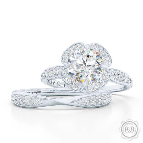 Exquisite Diamond Halo Engagement Ring crafted in White Gold and Platinum. Elegant Bead-Set Diamond Encrusted Shoulders and Crown. Find The Perfect GIA Certified Diamond for Your Budget. This Design Offers a Matching Wedding Band For Her. Free Shipping USA. 30Day Returns | BASHERT JEWELRY | Boca Raton Florida