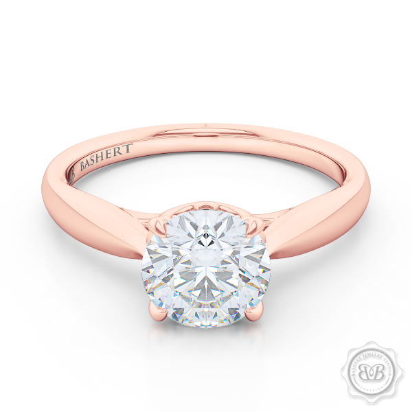 "Award-Winning Solitaire Engagement Ring Design. Classic Round Solitaire Handcrafted in Romantic Rose Gold. Signature ""Infinity Heart"" Crown Accentuated by Gently Tapered Shoulders. Forever One Round Brilliant Moissanite.  Free Shipping USA. 30-Day Returns 